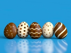 Chocolate Easter eggs on blue background
